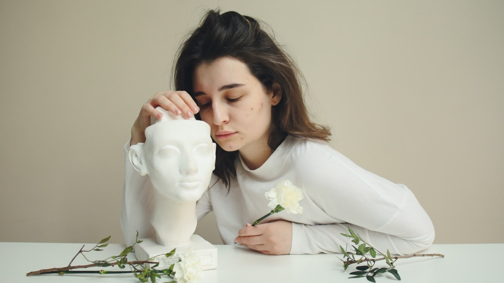 Girl acne sad statue.jpg